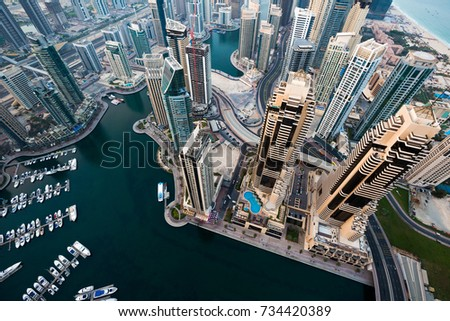 Dubai skyscrapers. Dubai Marina from above. Morning light. Futuristic skyline. Luxury homes, private property. Cayan tower view. #734420389