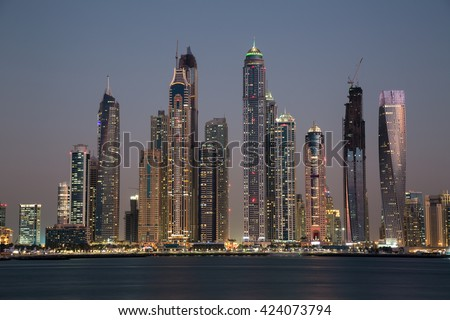 Dubai skyscrapers. Dubai Marina panoramic view, skyline, cityscape. Dubai evening skyline. Dubai sunset. Dubai futuristic skyline. Dubai Marina skyscrapers Princess Tower, Cayan tower, Marina 101.