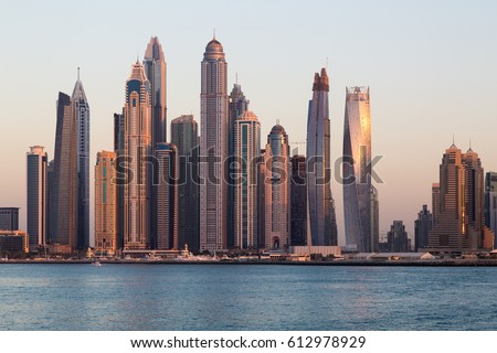 Dubai skyscrapers. Dubai Marina panoramic view, skyline, cityscape. Evening skyline. Dubai sunset. Dubai futuristic skyline. Skyscrapers Princess Tower, Cayan tower, Marina 101.