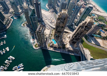 Dubai skyscrapers from above. Incredible Dubai view. Futuristic skyline. Dubai Marina aerial view. Skyscraper view.