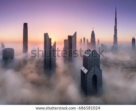 Dubai skyscrapers through the fog