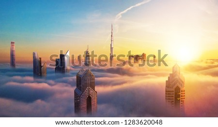Dubai sunset panoramic view of downtown covered with clouds. Dubai is super modern city of UAE, cosmopolitan megalopolis. Very high resolution image #1283620048