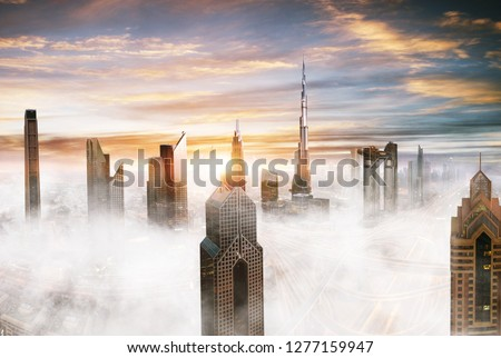 Dubai sunset panoramic view of downtown with low clouds. Dubai is super modern city of UAE, cosmopolitan megalopolis. Very high resolution image #1277159947