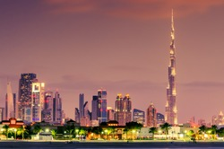 Dubai, the United Arab Emirates: skyline of skyscrapers of Downtown at beautiful violet sunset. Famous Burj Khalifa - the tallest building in the world.