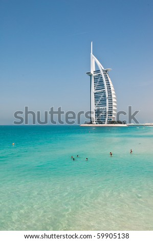 DUBAI, UAE - APRIL 05: The grand sail shaped Burj al Arab Hotel taken April 5, 2010 in Dubai. The hotel is classed as one of the most luxurious in the world and is located on a man made island. - stock photo