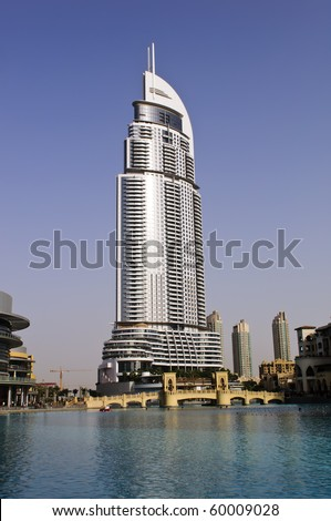 DUBAI, UAE - AUG 03: The Address Hotel in the downtown Dubai area overlooks the famous dancing fountains, taken on 3rd August 2010 in Dubai. The hotel is surrounded by a mall, hotels and Burj Khalifa