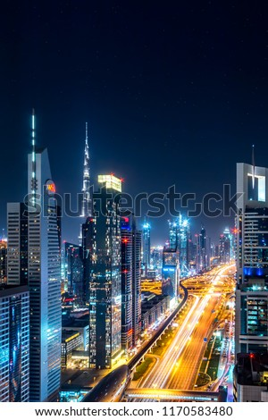 DUBAI, UAE - AUGUST, 2017: Futuristic cityscape scene of Dubai with Sheikh zayed road and Burj Khalifa. Tallest tower.  #1170583480