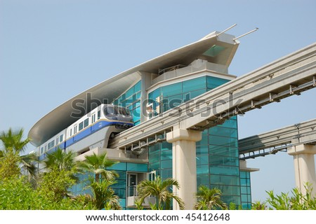 DUBAI, UAE - AUGUST 28: The Palm Jumeirah monorail station and train on August 28, 2009 in Dubai, United Arab Emirates. It is located on a man-made island Palm Jumeirah.