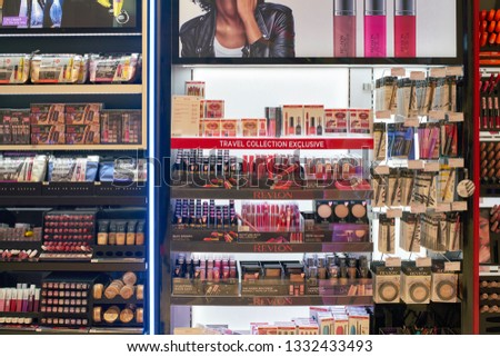 DUBAI, UAE - CIRCA FEBRUARY, 2019: Revlon makeup products on display at Dubai International Airport. #1332433493