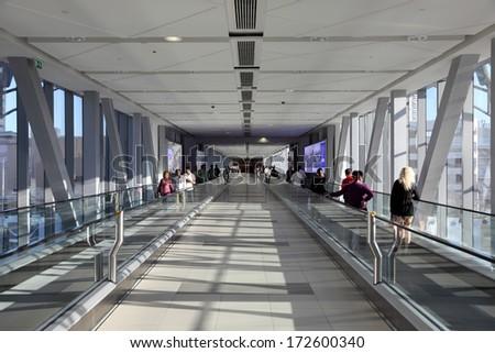 DUBAI, UAE - DEC 28: Gangway to Dubai Mall from the Burj Khalifa Metro Station. Dubai, December 28, 2013, United Arab Emirates #172600340