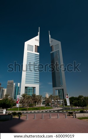 DUBAI, UAE - DEC 04: The iconic Emirates Towers of Dubai taken on Dec 4, 2009 in Dubai.  One of the two towers is a hotel and the other is an office building with a Boulevard of shops and restaurants.