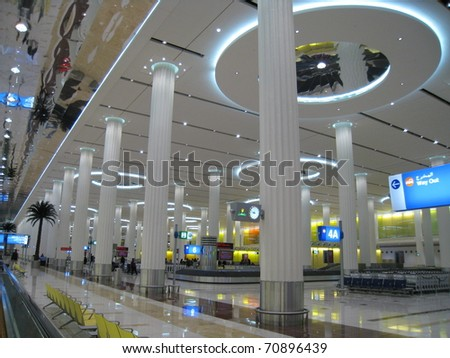 DUBAI, UAE - DEC 19: The new Emirates Terminal in Dubai International Airport on December 19, 2008 in Dubai, UAE. The maximum throughput of the airport is 80 million passengers in a year.
