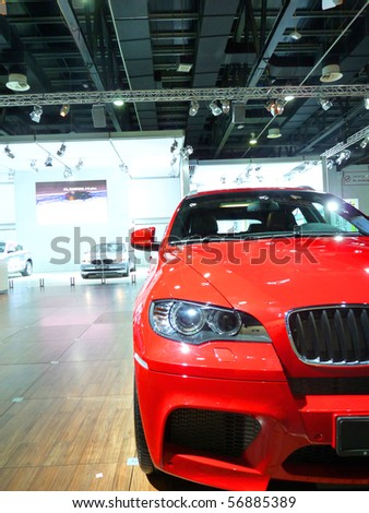DUBAI, UAE - DECEMBER 19: BMW Red Vehicle on display during Dubai Motor Show 2009 at Dubai Int'l Convention and Exhibition Centre December 19, 2009 in Dubai, United Arab Emirates.