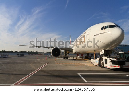 DUBAI, UAE - DECEMBER 26: Emirates Boeing 777 at Dubai Airport on December 26, 2012 in Dubai, UAE. Emirates is rated as a top 10 best airline in the world flying on youngest fleet.
