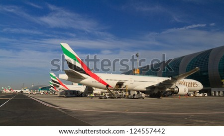 DUBAI, UAE - DECEMBER 26: Emirates planes at Dubai Airport on December 26, 2012 in Dubai, UAE. Emirates handles major part of passenger traffic and aircraft movements at the airport.