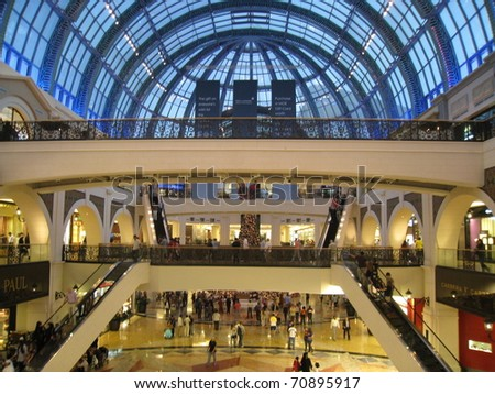 DUBAI, UAE - DECEMBER 28: Shoppers at Dubai Mall December 28, 2010 in Dubai, United Arab Emirates. Dubai Mall is one of the largest mall in the world.