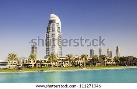 DUBAI, UAE - FEB 02: The Address Hotel in the downtown Dubai area overlooks the famous dancing fountains, taken on February 2, 2012 in Dubai, UAE. The hotel is surrounded by a mall, hotels and Burj Khalifa