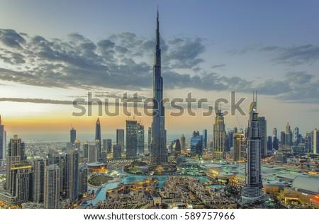 DUBAI, UAE - February 18: Burj Khalifa the tallest building in the world. Dubai Downtown cityscape. Dubai evening skyline, busy roads, sunset on February 18, 2017 in Dubai.
