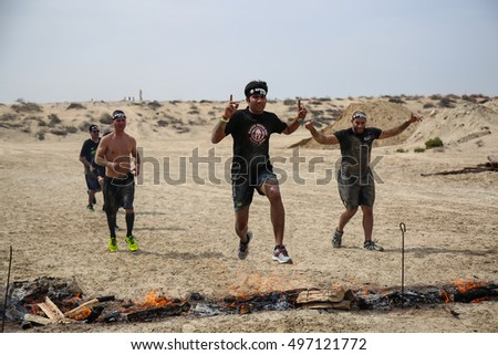 DUBAI, UAE - FEBRUARY 26, 2016: Competitors participate in the 2016 obstacle racing challenge in Dubai, United Arab Emirates, on February 26, 2016. - Shutterstock ID 497121772