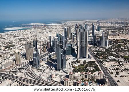 DUBAI, UAE. - FEBRUARY 6 : Dubai, the top view on Dubai downtown from the tallest building in the world, Burj Khalifa, at 828m. on February 6, 2012 in Dubai, UAE. Day View - stock photo