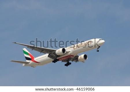 DUBAI, UAE - JAN 25: Emirates Airline Airplane Boeing 777-300 ER lands at Dubai International Airport January 24, 2010 Dubai, United Arab Emirates