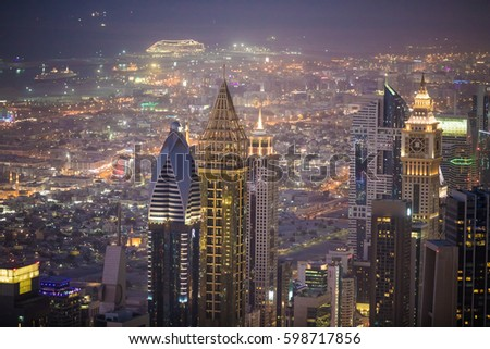 DUBAI, UAE - JANUARY 28, 2017: Dubai evening skyline with skyscrapers of Sheikh Zayed road on 28 Jaunuary 2017 in Dubai, UAE #598717856