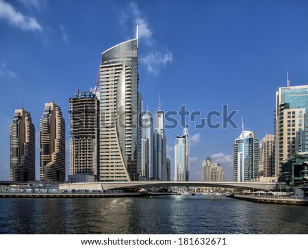DUBAI, UAE - JANUARY 17, 2014: View at modern skyscrapers in Dubai Marina in Dubai, UAE. When the entire development is complete, it will accommodate more than 120,000 people. #181632671