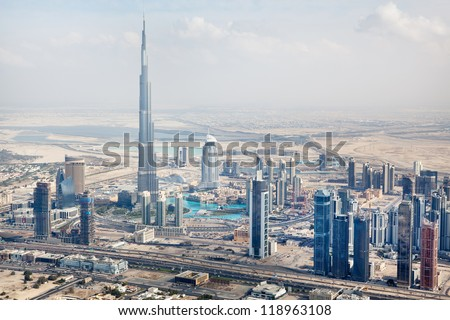 DUBAI, UAE - JANUARY 20: View at Sheikh Zayed Road skyscrapers in Dubai at January 20, 2011. More than 25 skyscrapers taller than 100 meters and the highest building in the wordl Burj Khalifa