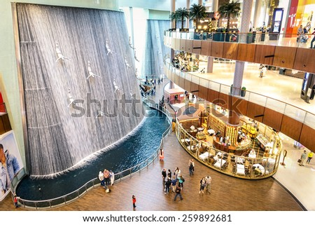 DUBAI UAE JANUARY 10 2015 wide view of artistic waterfalls in Dubai Mall the world's largest shopping mall part of the 20 billion dollars Downtown Dubai Complex and includes around 1 200 shops