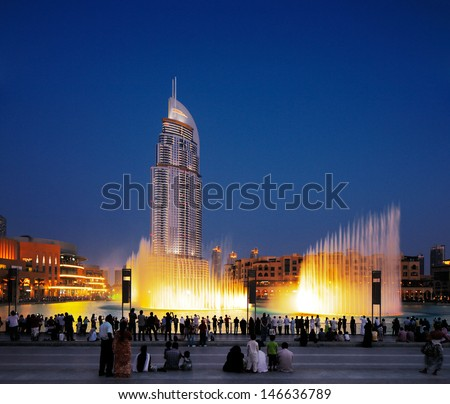 Dubai, Uae - Jul3 : The Dubai Fountain On Jul 3, 2013 In Dubai. Dubai\'S Best Attraction, With 6600 Lights, 275 M Long And Shoots Water Up To 150 M Into The Air Accompanied By A Range Of World Music