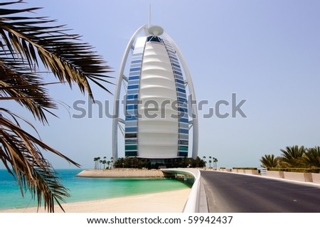 DUBAI, UAE - JULY 30: The grand sail shaped Burj al Arab Hotel taken July 30th, 2010 in Dubai. The hotel is classed as one of the most luxurious in the world and is located on a man made island. - stock photo