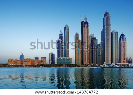 DUBAI, UAE - JUN 18: A view of Dubai Marina at Dusk on Jun 18, 2013 in Dubai, UAE. The Marina in Dubai has more tall towers over 50 stories than Manhattan New York City