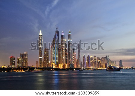 DUBAI, UAE -MARCH 23: View of modern skyscrapers in Dubai Marina on March 23, 2013 in Dubai, UAE. Dubai Marina - artificial canal city, carved along a 3 km stretch of Persian Gulf shoreline.