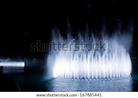 DUBAI, UAE - MAY 23: A record-setting fountain system set on Burj Khalifa Lake on May 23, 2011. Illuminated by 6600 lights and 25 projectors, it shoots water 150 m into the air.