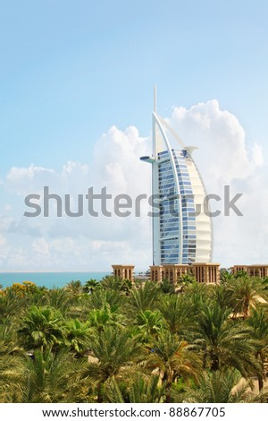 DUBAI, UAE - MAY 26: Burj Al Arab hotel on May 26, 2011 in Dubai. Burj Al Arab is a luxury 5 star hotel built on an artificial island in front of Jumeirah beach. - stock photo