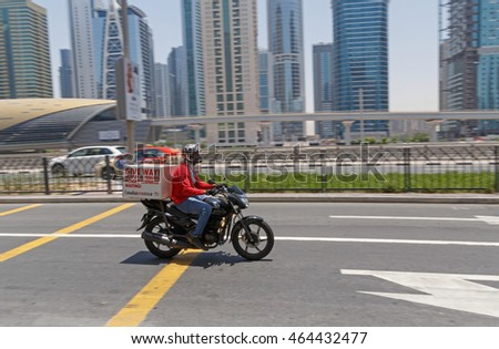 DUBAI, UAE - MAY 20, 2016: motorcycle food delivery service
