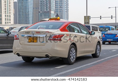 DUBAI, UAE - MAY 11, 2016:  taxi on Sheikh Zayed Road