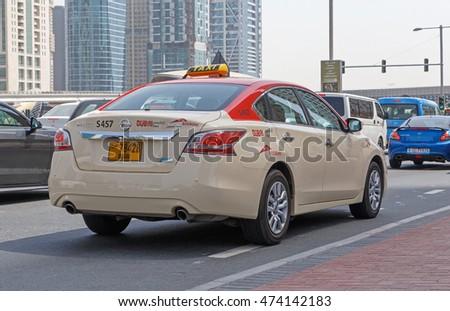DUBAI, UAE - MAY 11, 2016:  taxi on Sheikh Zayed Road
