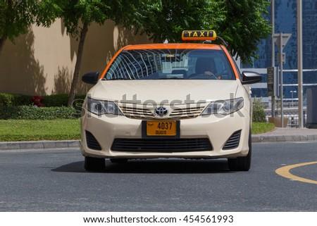 DUBAI, UAE - MAY 11, 2016:  taxi on street in Dubai