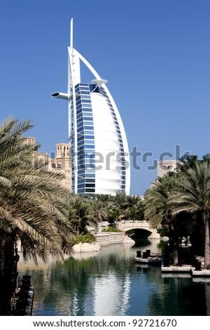 DUBAI, UAE - NOV. 15: View at hotel Burj al Arab from Madinat Jumeirah in Dubai at November 15, 2010. Madinat Jumeirah encompasses two hotels and clusters of 29 traditional Arabic houses.