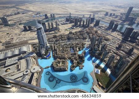 DUBAI, UAE - NOVEMBER 22: Address Hotels, Souk Al Bahar, Palace The Old Town and Lake Burj Dubai on November 22, 2010 in Dubai, UAE. View Downtown Dubai from the height of the Burj Khalifa.