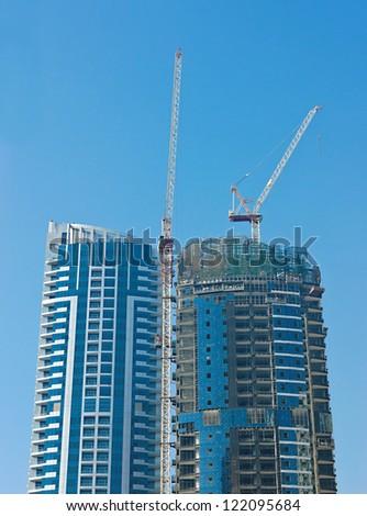 DUBAI, UAE - NOVEMBER 13: Built modern buildings on November 13, 2012 in Dubai, UAE. Dubai has built the highest skyscrapers in the world.
