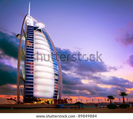 DUBAI, UAE - NOVEMBER 27: Burj Al Arab hotel on Nov 27, 2011 in Dubai. Burj Al Arab is a luxury 5 stars hotel built on an artificial island in front of Jumeirah beach. Sunset View - stock photo
