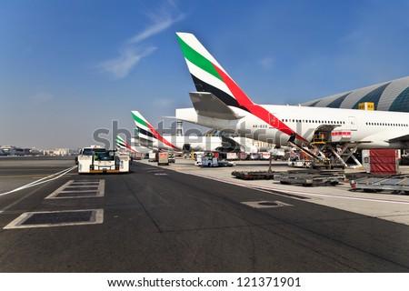 DUBAI, UAE - NOVEMBER 10: Emirates planes at Dubai Airport on November 10, 2012 in Dubai, UAE. Emirates handles major part of passenger traffic and aircraft movements at the airport.
