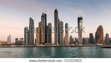DUBAI, UAE - NOVEMBER 26: Skyscrapers in Dubai Marina at sunset, United Arab Emirates, Nov 26, 2011 Dubai is the most expensive city in the Middle East.