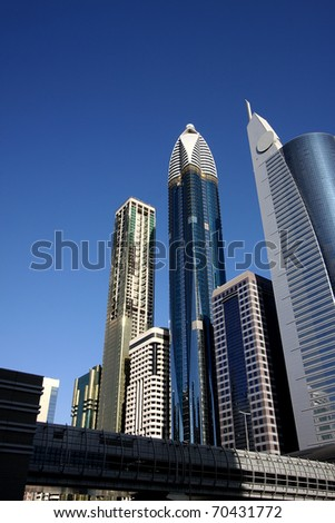 DUBAI, UAE - NOVEMBER 17: View at Sheikh Zayed Road skyscrapers and metro station in Dubai at November 17, 2010. More than 25 skyscrapers taller than 100 meters can be found there.