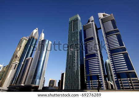DUBAI, UAE - NOVEMBER 17: View at Sheikh Zayed Road skyscrapers in Dubai at November 17, 2010. More than 25 skyscrapers taller than 100 meters can be found there.