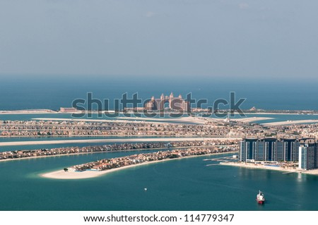 DUBAI, UAE - NOVEMBER 26: View on artificial island Palm Jumeirah and Atlantis hotel in Dubai, UAE on November 26, 2011. It is one of three islands called the Palm Islands at Dubai`s coastline.