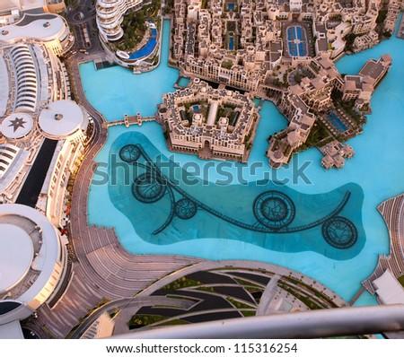 DUBAI, UAE - NOVEMBER 26: View on Dubai Fountain from the lookout Burj Khalifa. Dubai, United Arab Emirates. Nov 26, 2011. Dubai is the most expensive city in the Middle East.
