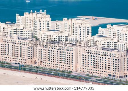 DUBAI, UAE - NOVEMBER 26:View on residential buildings on Palm Jumeirah island at November 26, 2011, Dubai. The Palm Jumeirah is an artificial archipelago in Dubai emirate, UAE